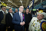 © Joel Goodman - 07973 332324 . 24/02/2017 . Stoke-on-Trent , UK . PAUL NUTTALL listens as Gareth Snell gives his victory speech at the count in the by-election for the constituency of Stoke-on-Trent Central after losing , at Fenton Manor Sports Complex . Photo credit : Joel Goodman