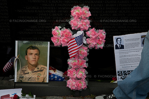Photographer: Lucian Perkins/Facing Change: Documenting America.Washington,  DC.May 29, 2011..Caption: Flowers and a flag are left at the Viet Nam Memorial Statue.