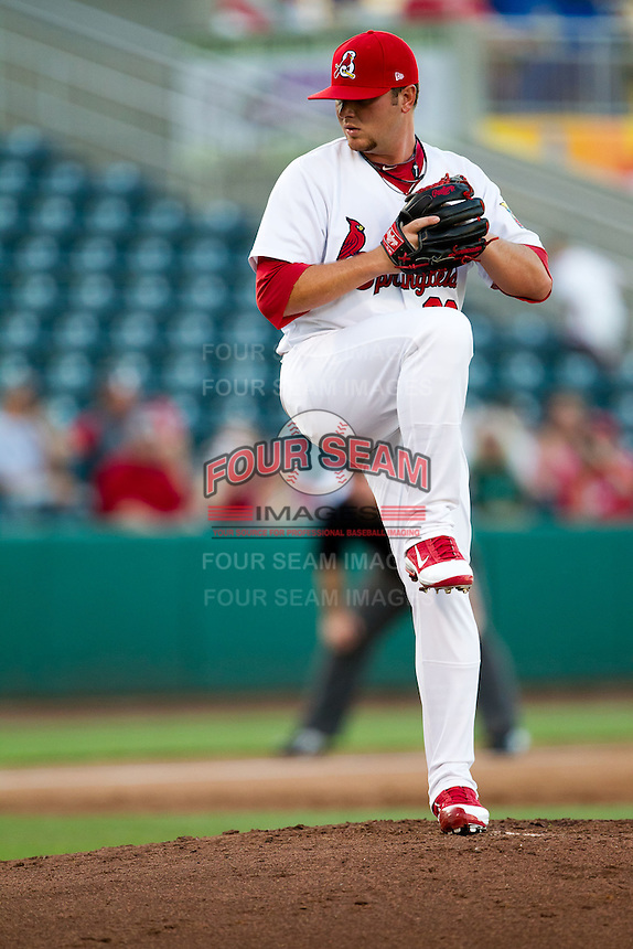 Daniel Calhoun (39) of the Springfield Cardinals winds up during a game against the Tulsa Drillers at Hammons Field on July 18, 2011 in Springfield, Missouri. Tulsa defeated Springfield 13-8. (David Welker / Four Seam Images)