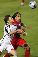 New England Revolution defender Chase Hilgenbrinck (25) and Crystal Palace forward Sergio Flores (11). The New England Revolution (MLS) defeated Crystal Palace FC USA of Baltimore (USL2) 5-3 in penalty kicks after finishing regulation and overtime tied at 1-1 during a Lamar Hunt US Open Cup quarterfinal match at Veterans Stadium in New Britain, CT, on July 8, 2008.