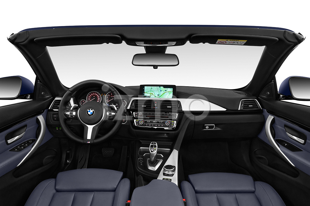Stock photo of straight dashboard view of a 2018 BMW 4 Series M Sport 2 Door Convertible