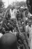 Sudan. Southern part. Bahr El Ghazal. Marial Lou. Dinka tribe area. A watchman working for the ngo (non governmental organisation) MSF Switzerland ( Médecins Sans Frontières. Doctors without Borders) tries to organise the crowd ( men, mothers and children) waiting for a food distribution. © 1998 Didier Ruef