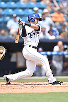 Asheville Tourists second baseman Forrest Wall (7) swings at a pitch during a game against the Rome Braves on May 17, 2015 in Asheville, North Carolina. The Tourists defeated the Braves 9-8. (Tony Farlow/Four Seam Images)