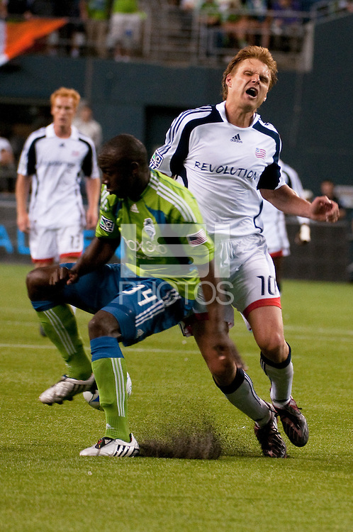 Edgaras Jankauskas (10) of the New England Revolution collides with Jhon Kennedy Hurtado (34) of the Seattle Sounders in the match at the XBox Pitch at Quest Field on August 20, 2009. The Revolution defeated the Sounders 1-0.