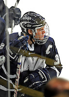 1 February 2008: University of New Hampshire Wildcats' forward Matt Fornataro, a Senior from Calgary, Alberta, takes a breather on the bench during a television time-out during a game against the University of Vermont Catamounts at Gutterson Fieldhouse in Burlington, Vermont. The seventh-ranked Wildcats defeated the Catamounts 5-1in front of a sellout crowd of 4,003...Mandatory Photo Credit: Ed Wolfstein Photo