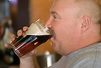 David Bruns drinks one of the first beers sold at Old Bag of Nails restaurant and bar in downtown Westerville, Ohio, Thursday, February 23, 2006. The business occupies a building at the main crossroads in the city that was home to the Anti-Saloon League.<br />