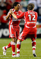 Chicago Fire midfielder Logan Pause (12) congratulates Chicago Fire midfielder Diego Gutierrez (8) on scoring the Fire's second goal.  The Chicago Fire defeated the New York Red Bulls 2-1 at Toyota Park in Bridgeview, IL on September 3, 2006..