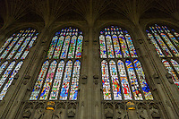 UK, England, Cambridge.  King's College Chapel, Stained Glass Windows above Symbols of Royal Lineage.