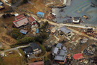 Houses lie in ruins in this coastal city of Japan. Helicopter Antisubmarine Squadron 14 is conducting humanitarian assistance and search-and-rescue operations on the eastern coast of Japan in support of Operation Tomodachi.