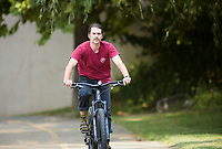 Jake Lee of Fayetteville rides, Friday, September 10, 2021 along the Razorback Greenway in Rogers. Check out nwaonline.com/210912Daily/ for today's photo gallery. <br /> (NWA Democrat-Gazette/Charlie Kaijo)