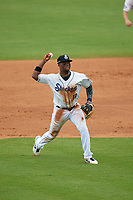 Biloxi Shuckers shortstop Luis Aviles Jr. (11) throws home during a Southern League game against the Montgomery Biscuits on May 8, 2019 at MGM Park in Biloxi, Mississippi.  Biloxi defeated Montgomery 4-2.  (Mike Janes/Four Seam Images)