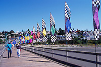 White Rock, BC, British Columbia, Canada - Colourful Banners and Flags displayed on White Rock Pier along Semiahmoo Bay, Summer