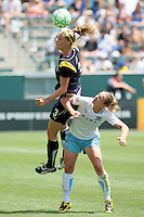 Allison Falk #3 of the Los Angeles Sol heads a ball over Lindsay Tarpley #5 of the Chicago Red Stars during their WPS game at The Home Depot Center on June 27,2009 in Carson, California.  The Sol defeated the Red Stars 4-0.
