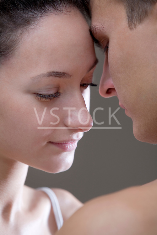Close-up of young couple face to face