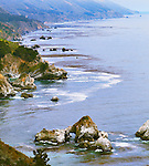 Along the magnificent Big Sur California coastline the Pacific Ocean washes steep cliffs and sea stacks, rock arches and sandy coves in a dramatic  seascape along California State HIghway 1 between Monterey and San Luis Obispo, California on the Central Coast.