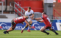 5th September 2020; Kingsholm Stadium, Gloucester, Gloucestershire, England; English Premiership Rugby, Gloucester versus London Irish; Paddy Jackson of London Irish is tackled by Jack Clement and Fraser Balmain of Gloucester