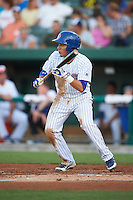 South Bend Cubs second baseman Carlos Sepulveda (2) squares to bunt during a game against the Burlington Bees on July 22, 2016 at Four Winds Field in South Bend, Indiana.  South Bend defeated Burlington 4-3.  (Mike Janes/Four Seam Images)
