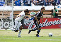 June 20, 2009:  Jovan Kirovski of Galaxy grabs to slow down Antonio Ribeiro of Earthquakes during a game at Coliseum in Oakland, California. San Jose Earthquakes defeated Los Angeles, 2-1.