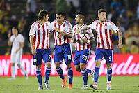 Pasadena, CA - Tuesday June 07, 2016: Paraguay midfielder Oscar Romero (21), defender Paulo Da Silva (14), defender Victor Ayala (20), and forward Antonio Sanabria (9) during a Copa America Centenario Group A match between Colombia (COL) and Paraguay (PAR) at Rose Bowl Stadium.