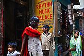 Locals seen outside a music school at the ancient city of Varanasi in Uttar Pradesh, India. Photograph: Sanjit Das/Panos