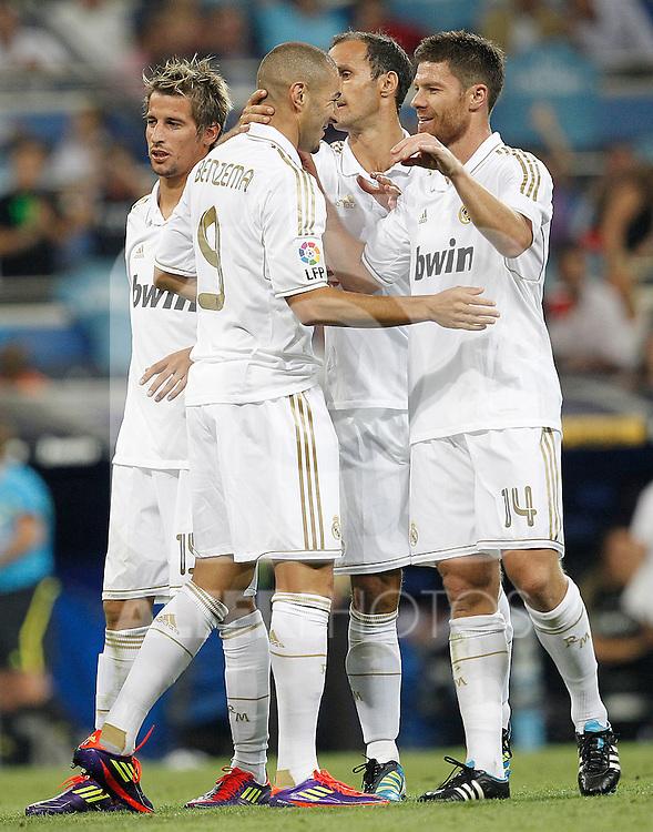 Real Madrid's Karim Benzema celebrates goal with Xabi Alonso, Fabio Coentrao and Ricardo Carvalho during Santiago Bernabeu Cup on august 24th 2011...Photo: Cesar Cebolla / ALFAQUI