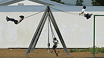 Children play on the public swing set at Edison McNair Academy, in East Palo Alto, California.