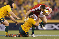 MELBOURNE, 29 JUNE 2013 - Tommy BOWE of the Lions is tackled by Michael HOOPER of the Wallabies during the Second Test match between the Australian Wallabies and the British & Irish Lions at Etihad Stadium on 29 June 2013 in Melbourne, Australia. (Photo Sydney Low / sydlow.com)