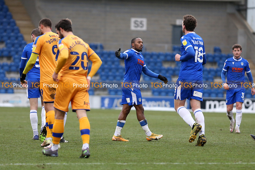 Callum Harriott (C) of Colchester United scores the first goal for his team and celebrates during Colchester United vs Mansfield Town, Sky Bet EFL League 2 Football at the JobServe Community Stadium on 14th February 2021