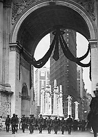 Col. Donovan and staff of 165th Inf., passing under the Victory Arch, N.Y.C. 1919. Paul Thompson. (War Dept.)<br /> Exact Date Shot Unknown<br /> NARA FILE #:  165-WW-80A-8<br /> WAR & CONFLICT BOOK #:  721