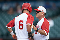 North Carolina State Wolfpack head coach Elliott Avent (9) talks with Brett Kinneman (6) against the Boston College Eagles in Game Two of the 2017 ACC Baseball Championship at Louisville Slugger Field on May 23, 2017 in Louisville, Kentucky. The Wolfpack defeated the Eagles 6-1. (Brian Westerholt/Four Seam Images)
