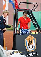 13-08-13, Netherlands, Raalte,  TV Ramele, Tennis, NRTK 2013, National Ranking Tennis Champ,  Rosalie van de Hoek receives new balls<br /> <br /> Photo: Henk Koster