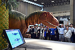 September 7, 2014, Makuhari, Japan - A dinosaur dances and jumps while being controlled by a smartphone at CEATEC, Asia's largest IT and electronics trade show opened in Makuhari, east of Tokyo, on Tuesday, September 7, 2014. CEATEC, short for Combined Exhibition of Advanced Technologies, provides a platform for companies and organizations from all over the world to showcase their cutting-edge products, services and technologies. (Photo by Natsuki Sakai/AFLO)