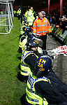 Grimsby Town 1 Lincoln City 3, 28/12/2014. Blundell Park, Football Conference. Police presence in front of the Lincoln fans.  Photo by Paul Thompson.