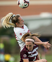 Hawgs Illustrated/BEN GOFF <br /> Parker Goins (left) of Arkansas jumps for a header vs Kendall Ritchie of Texas A&M in the first half Thursday, Sept. 20, 2018, at Razorback Field in Fayetteville.