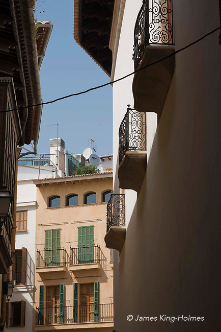 Balconies on upper stories of buildings in the Calle de la Portella, Palma de Mallorca, Spain.