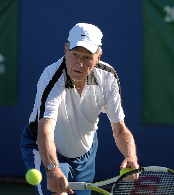 DELRAY BEACH, FL  - DECEMBER 04: Tennis legend Chris Evert teamed with her good friend former President George H.W. Bush to outlast recording star Michael W. Smith and world No. 1 Lindsay Davenport 6-4 in the highlight match at the Chris Evert/Bank of America Pro-Celebrity Tennis Classic on Sunday at the Delray Beach Tennis Center. Bush was among the many celebrities and tennis stars that helped Evert raise a record-tying $1.2 million to fight drug abuse in South Florida. The event, which is held in association with the Chris Evert Children's Hospital at Broward General Medical Center, has raised more than $14.2 million in 16 years. December 3, 2005 in Delray Beach, Florida.<br /> <br /> People:  George H.W. Bush