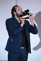 """Director Kiro Russo poses with the Special Orizzonti Jury Prize for """"El Gran movimento"""" during the Winners Red Carpet as part of the 78th Venice International Film Festival in Venice, Italy on September 11, 2021. <br /> CAP/MPI/IS/PAC<br /> ©PAP/IS/MPI/Capital Pictures"""