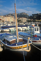 Fishing boats and the village of Cassis in southern France.