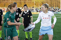 Lindsay Tarpley excepts Athletica momento from Lori Chalupny prior to the game. They are laughing because Chalupny almost forgot to give it to Tarpley..Saint Louis Athletica were defeated 1-0 by Chicago Red Stars on a Lindsay Tarpley goal. This was the inaugural game for both sides. Played at Korte Stadium, Edwardsville, IL.
