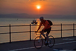 Swansea, UK, 24th April 2020.<br />The sun rises over seafront at Mumbles near Swansea today as government warnings continue to ask people to stay at home due to the Coronavirus outbreak that is spreading across the UK and the world.