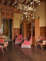 The furniture was designed for the house by Gaspar Homar, including an elaborately crafted Art Nouveau settee with built in marquetry cabinets