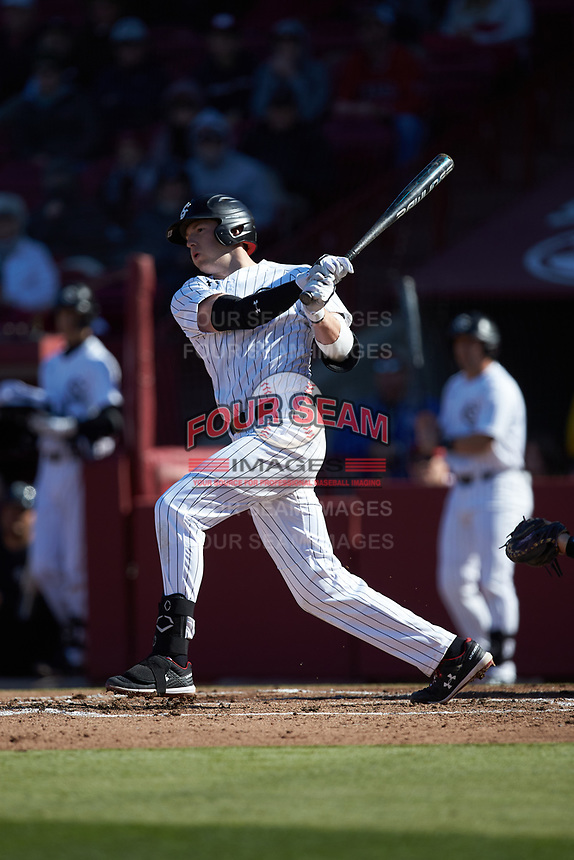 Braylen Wimmer (3) of the South Carolina Gamecocks follows through on his swing against the Holy Cross Crusaders at Founders Park on February 15, 2020 in Columbia, South Carolina. The Gamecocks defeated the Crusaders 9-4.  (Brian Westerholt/Four Seam Images)