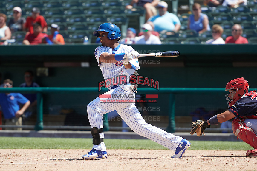 South Bend Cubs right fielder Eddy Martinez (15) at bat during the first game of a doubleheader against the Peoria Chiefs on July 25, 2016 at Four Winds Field in South Bend, Indiana.  South Bend defeated Peoria 9-8.  (Mike Janes/Four Seam Images)