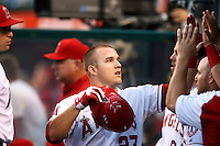 Mike Trout #27 of the Los Angeles Angels is greeted by his teammates during a game against the Chicago White Sox at Angel Stadium on September 22, 2012 in Anaheim, California. Los Angeles defeated Chicago 4-2. (Larry Goren/Four Seam Images)