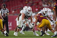 LOS ANGELES, CA - SEPTEMBER 11: Drake Nugent #60 of the Stanford Cardinal prepares to block after snapping the ball during a game between University of Southern California and Stanford Football at Los Angeles Memorial Coliseum on September 11, 2021 in Los Angeles, California.