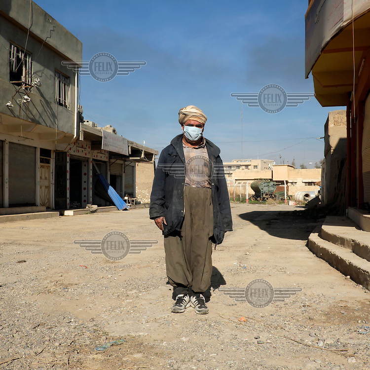Ismail, a street sweeper in the town of Qaraqosh. The town was captured by ISIS in August 2014 and it remained in their hands until November 2016.