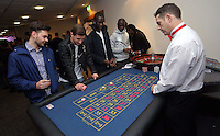 Pictured: Eder and Modou Barrow at the roulette table<br /> Re: Swansea City FC Christmas party at the Liberty Stadium, south Wales, UK.