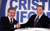 Il Presidente del Consiglio Silvio Berlusconi stringe la mano al presidente dei Cristiano Riformisti Antonio Mazzocchi, a sinistra, prima di intervenire al congresso in corso a Roma, 26 febbraio 2011..Italian Premier Silvio Berlusconi shakes hands with Italian Christians Reformists' president Antonio Mazzocchi, left, prior to speak at the congress, in Rome, 26 february 2011..UPDATE IMAGES PRESS/Riccardo De Luca