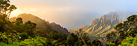 Heavy clouds and mist suddenly clear as the warm light from the setting sun sneaks into Kalalau Valley on Kaua'i, the Garden Island.