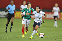 Sydney Leroux (2) of the USWNT goes against Lupita Worbis (8) of Mexico. The USWNT defeated Mexico 7-0 during an international friendly, at RFK Stadium, Tuesday September 3 , 2013.